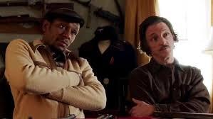 Yasiin Bey as Ordell Robbie & John Hawkes as Louis Gara