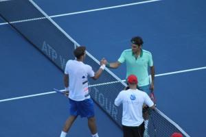Pospisil and Roger Federer (photo: Brian Taylor)