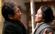 Chen Daoming as Lu Yanshi and Gong Li as Feng Wanyu in 'Coming Home'