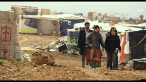 HE NAMED ME MALALA: Ziauddin Yousafzai and Malala Yousafzai and Syrian refugee Rimah in Syrian Refugee Tent Camp in Jordan. Feb 17, 2014.  Photo courtesy of Fox Searchlight Pictures.© 2015 Twentieth Century Fox Film Corporation All Rights Reserved